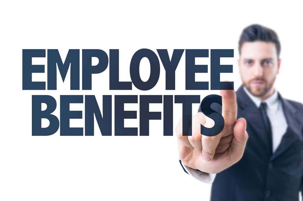 Business man pointing the text Employee Benefits